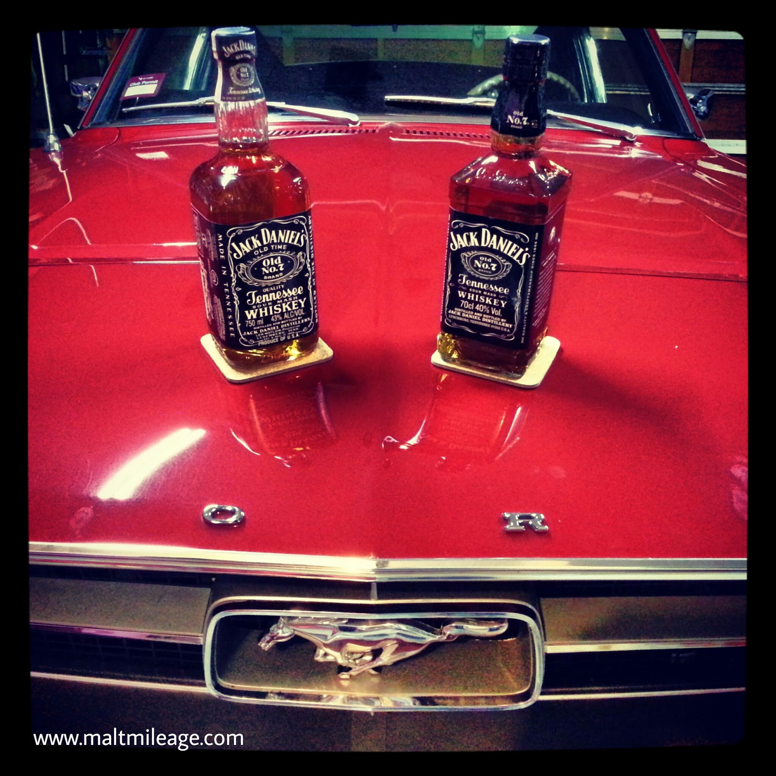 Three American Legends  My 1980 s and 2013 Jack Daniel s Old No 7 sitting  on the bonnet of a 1967 Ford Mustang in Melbourne e0587dcf24